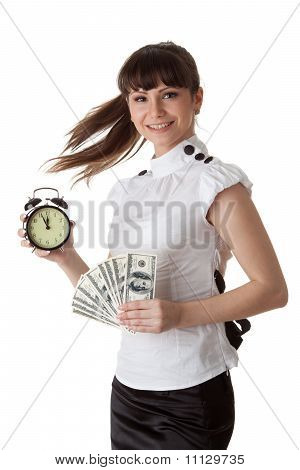 Businesswoman With Alarm Clock And Money