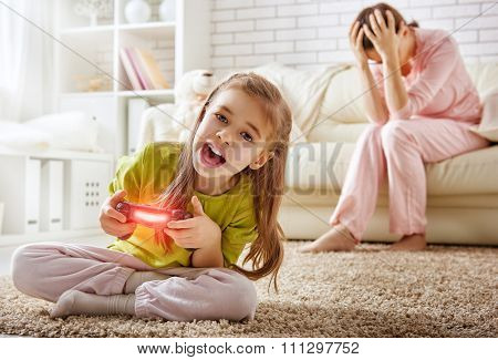 mother frustrating that her child playing video games