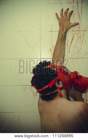 retro naked man with red gas mask, blood, despair and suicide