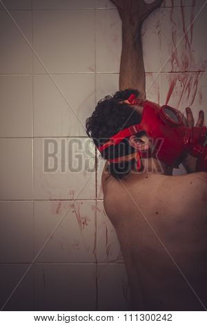 dead naked man with red gas mask, blood, despair and suicide