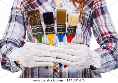 Woman With White Glove And Colorful Paintbrushes