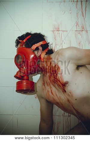 human naked man with red gas mask, blood, despair and suicide