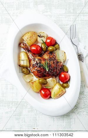 Honey glazed duck leg with oven-roasted vegetables