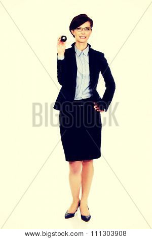 Businesswoman in glasses holding eight billiard ball.