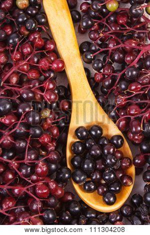 Heap Of Elderberry With Wooden Spoon, Healthy Food