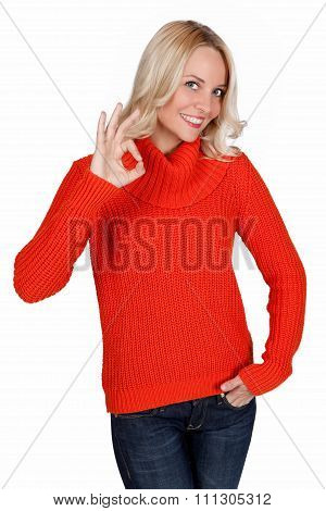 Blonde smiling young woman showing okay gesture
