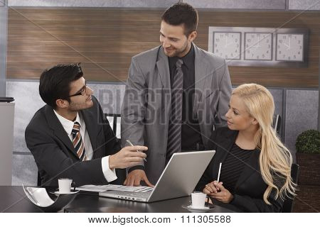 Young businesspeople working together in meetingroom.