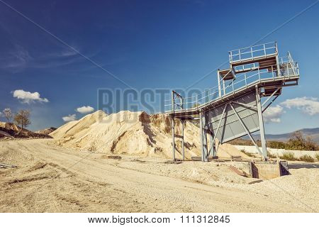 Gray metal observation building at a quarry shot on a clear sunny day