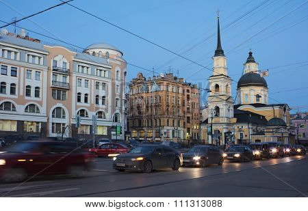 ST. PETERSBURG, RUSSIA - DECEMBER 8, 2015: Car traffic on the Belinsky street against the church of St. Simeon and St. Anna. The church was built in 1734 by design of M. Zemtsov and I. Blank