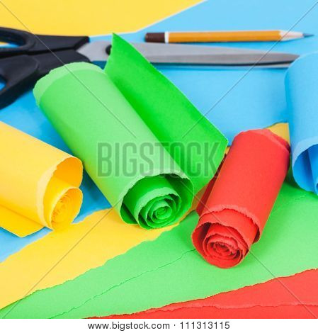 Rolled Color Paper On Sheets Of Plain Paper