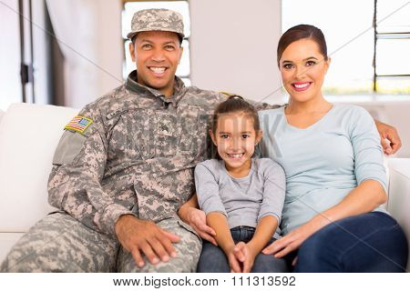 happy american military family relaxing at home