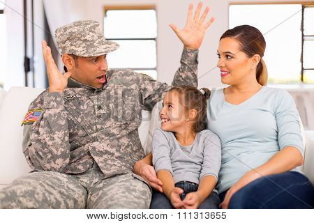 beautiful military family spending time together at home