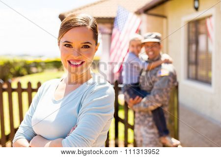 attractive young woman in front of family