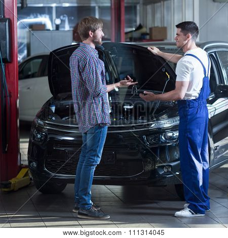Automotive Technician Talking With Client