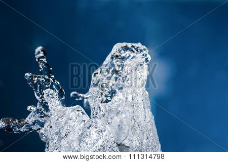 Water splash levitating in the air on blue