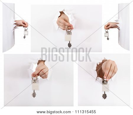 Set Of Hands Holding The Keychain Through A Hole