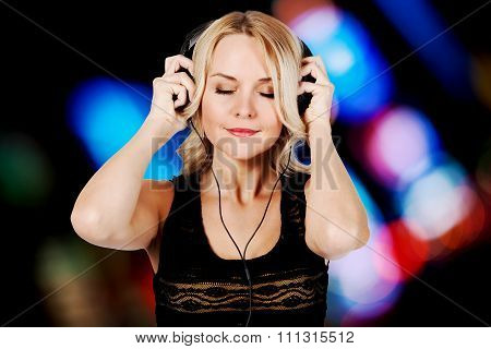 Blonde woman listen to music