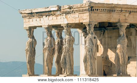 Caryatids at Acropolis in Greece against the sky.