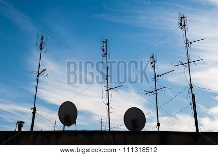 Group Of Old And New Antennas On Roof