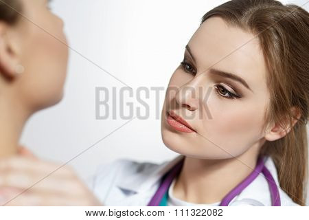 Beautiful Female Medicine Doctor With Serious Face Examine Patient