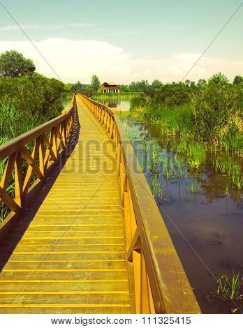 Wooden bridge and stilt house at the lake.