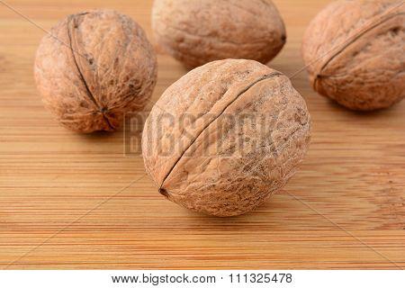 Wallnuts Over Wood