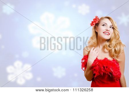 Pretty girl in dress on blurred digital snowflakes blue background