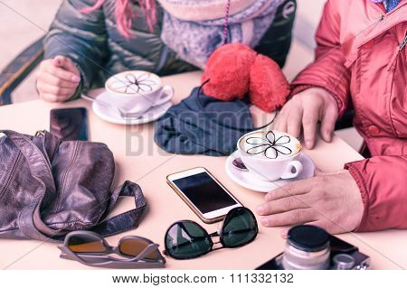 Friends drinking cappuccino at coffee bar restaurants - People hands with upper point of view -