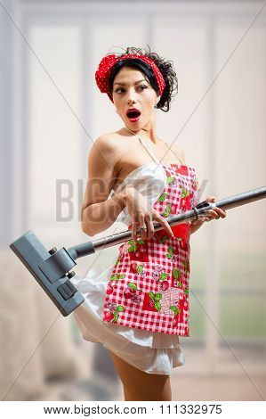 Surprized sexi pinup girl  holding vacuum cleaner