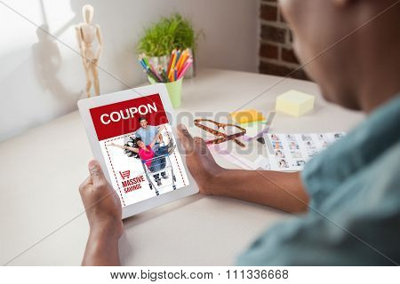 Photo editor using tablet pc against sale advertisement