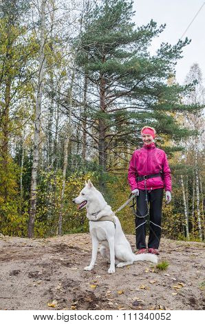 Woman With A White Dog In A Wood