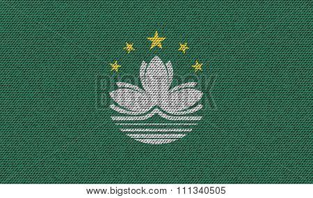 Flags Macau On Denim Texture.