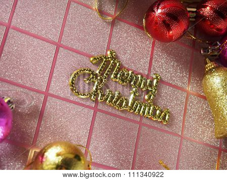 Merry Christmas Tag On Pink Tartan Background