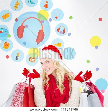 Happy festive blonde with shopping bags against dot pattern