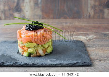 Salmon tartar with avocado, spring onion,tomato and caviar