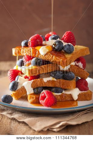 french toasts with creme fraiche and berries for breakfast