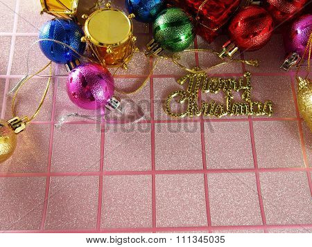 Christmas Background On Pink Tartan With Colorful Ornaments