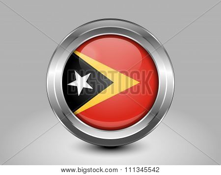 Flag Of East Timor. Metal Round Icon