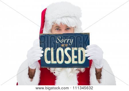 Festive father christmas holding page against vintage closed sign