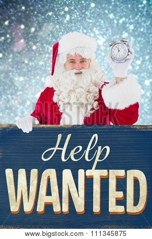 Santa claus holding alarm clock and sign against vintage help wanted sign