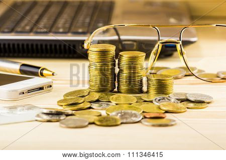 Selective Focus Of Golden Coins And The Accessory Of Business,warm Toning