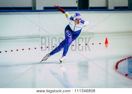 woman athlete runs speed skating sprint race on turn