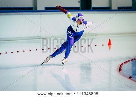 woman athlete runs speed skating sprint race on turn