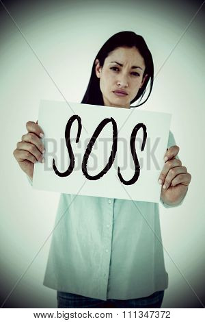 Sad woman showing sign against sos