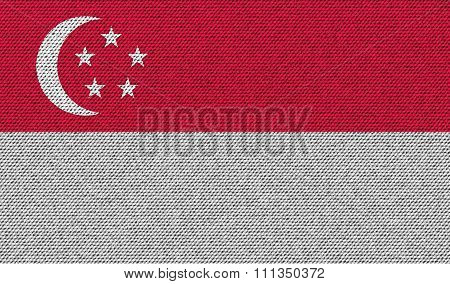 Flags Singapore. On Denim Texture.