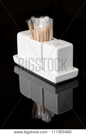 Saltcellar and pepper shaker with toothpicks