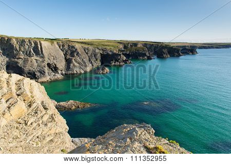 North Cornwall coastline near Newquay in summer from the south west coast path with waves breaking o