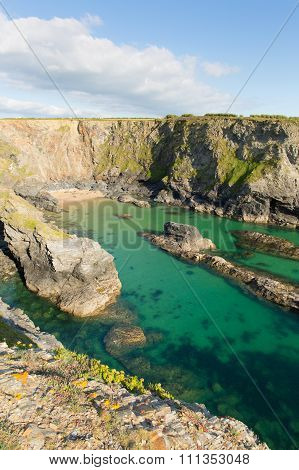 Fox Cove on the Cornwall coast between Treyarnon and Porthcothan with clear turquoise blue sea in su