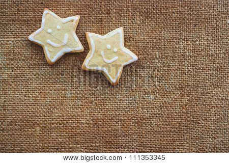 Two Christmas Cookies On The Flax Texture