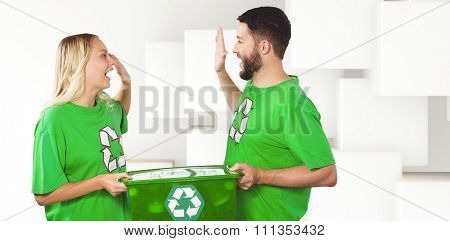 Smiling volunteer doing high five while holding container against abstract white design